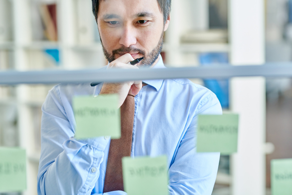 Man with sticky notes
